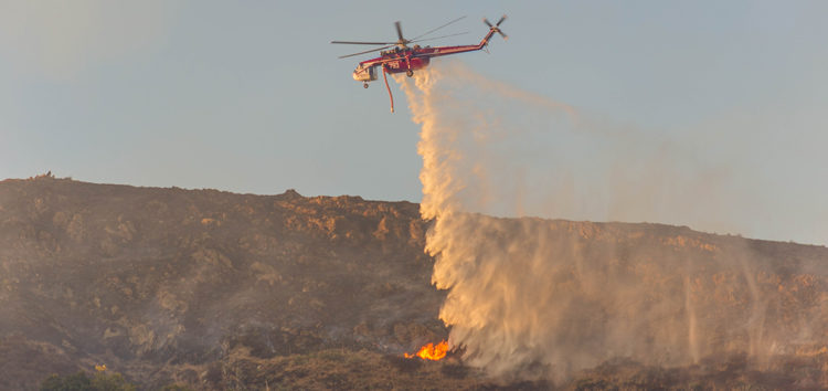 Fast moving brush fire forces evacuations at Cal Poly