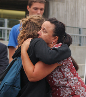 Kennedy Love's mother embraces a friend with hug.