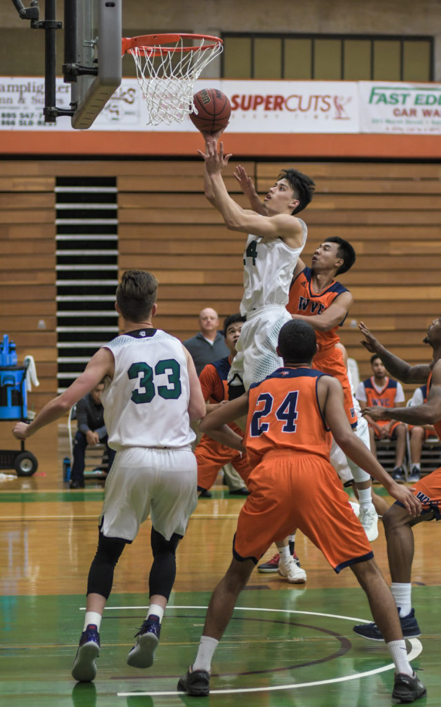 Finn Whetstone, 24, goes up for a shoot against West Valley College during Cuesta's Rabobank Tournament.
