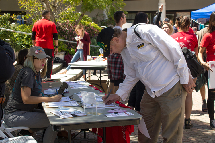Participants signing-up before the one mile march around the campus.